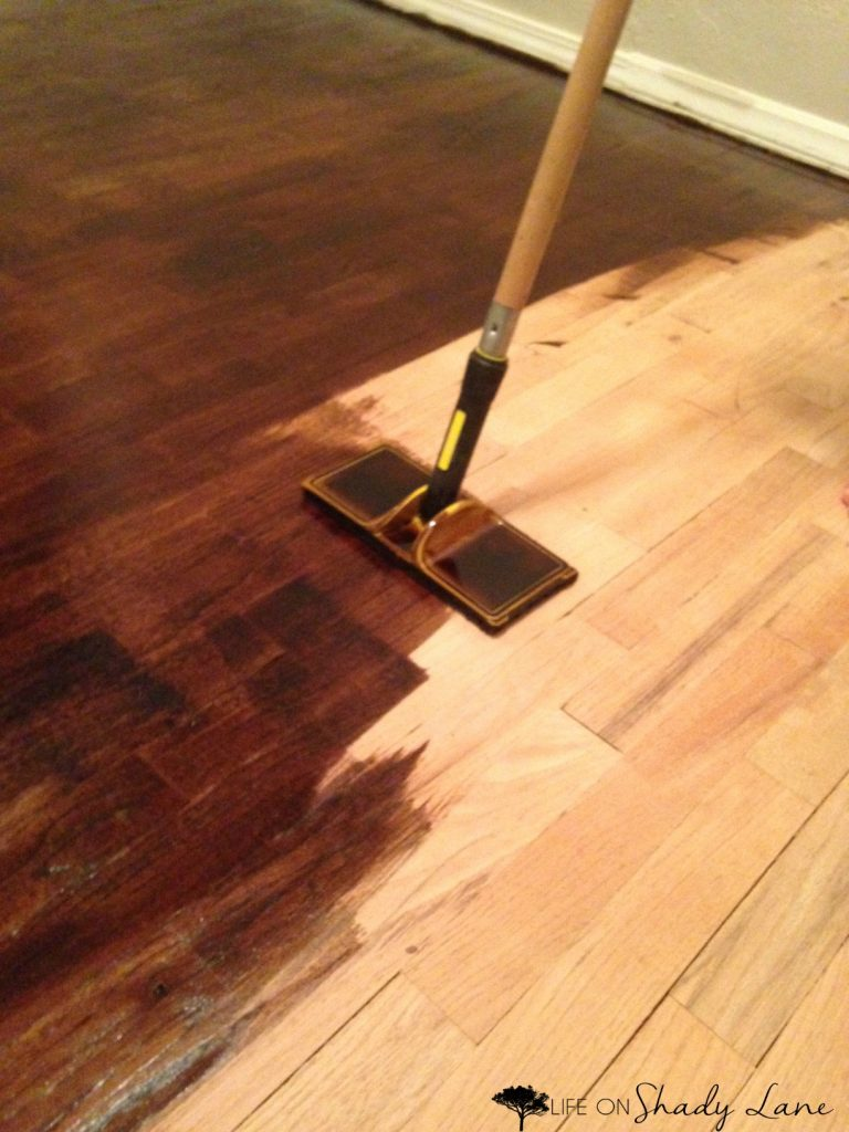 How to Refinish Wood Floors - a complete, step-by-step guide to refinishing wood floors by yourself instead of paying TONS of money for someone else to do it! Save money and get the exact look you want | #diy #woodflooring
