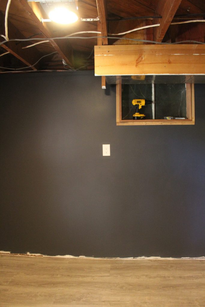 Man Cave Update: Painted Drywall and Flooring via Life on Shady Lane Blog