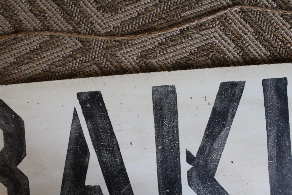 DIY: Antiqued Painted Sign // How to make a new, freshly painted sign look antique