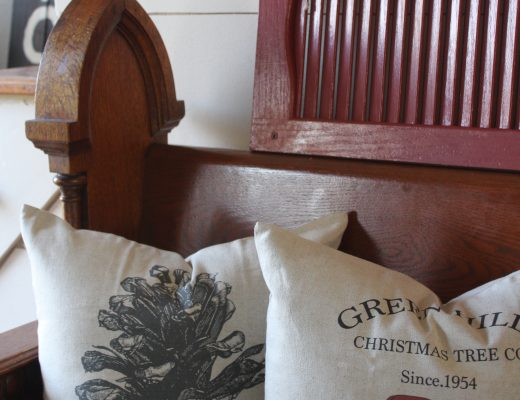Antique church pew and christmas pillows via Life on Shady Lane blog