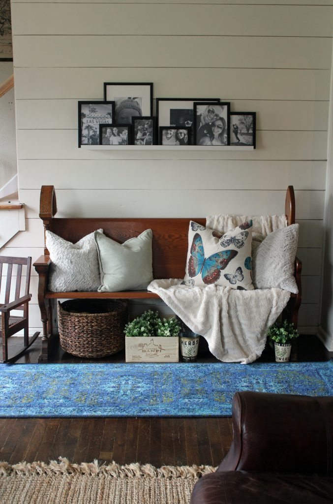 Blue runner rug, shiplap wall, black and white family photos | A pop of blue, modern farmhouse entryway via Life on Shady Lane blog