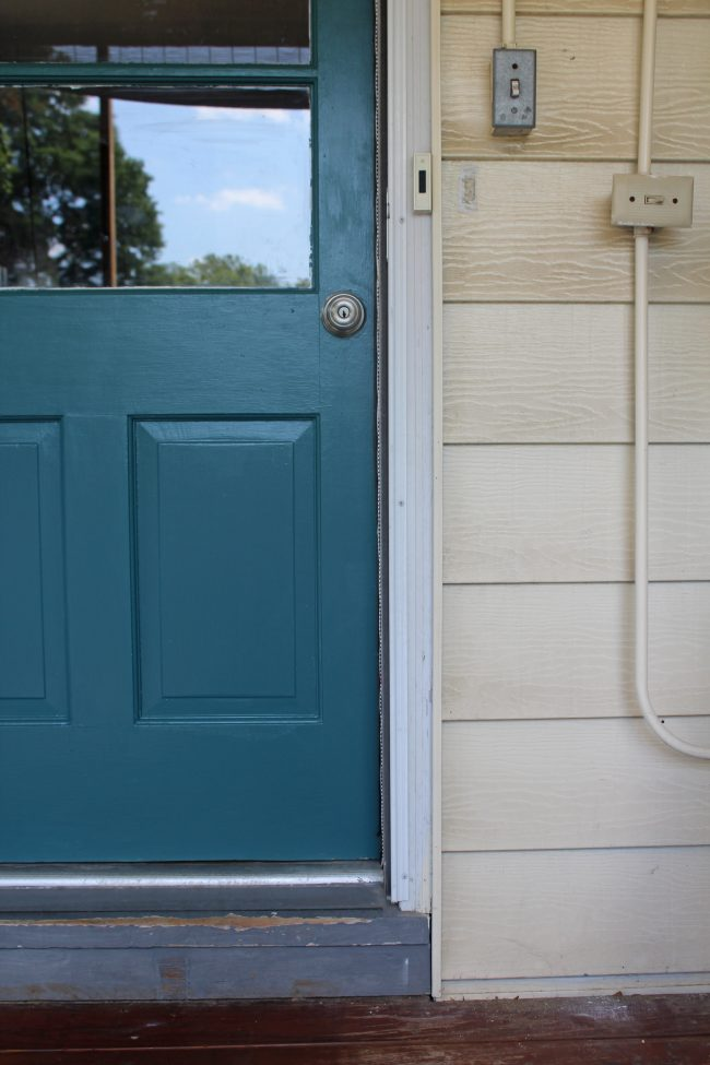 A quick and easy door makeover, teal exterior door and yellow house