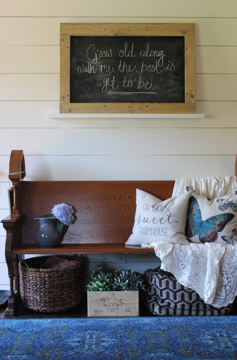 A DIY pallet wood framed chalkboard - inexpensive and simple way to make over a cheap chalkboard!