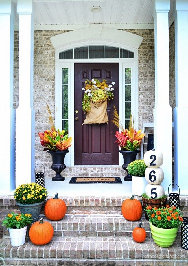 Inspiring Fall Porches - a roundup complete with traditional and non-traditional autumn colors, so there's something for everyone!