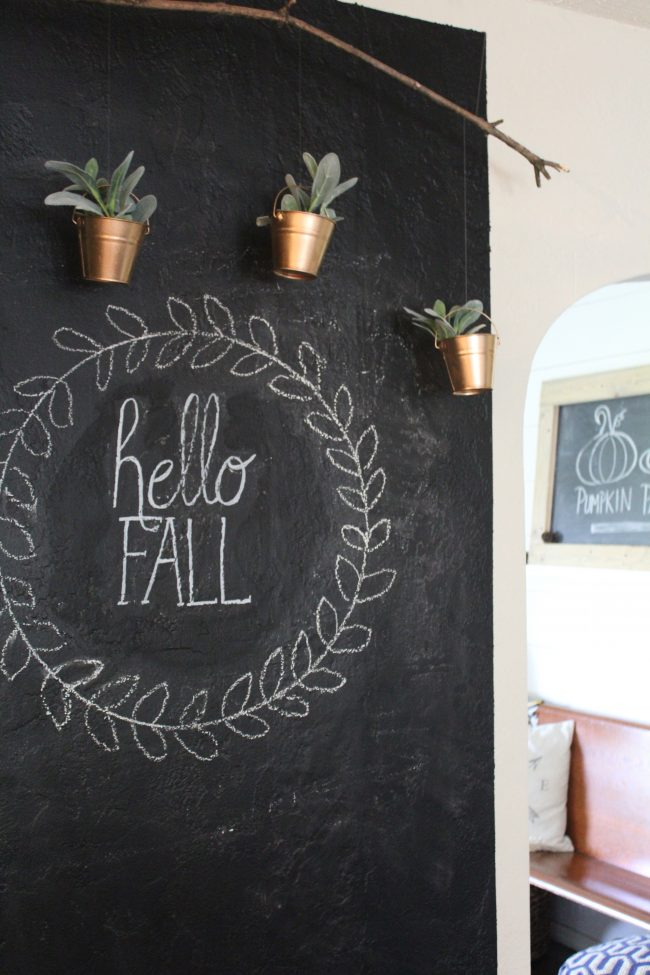 Chalkboard wall with hanging copper planters - perfect for turning a big, blank kitchen wall into something that is stylish, fun, and functional!
