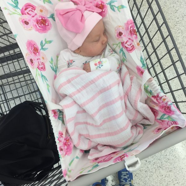"""Mom hack: A shopping cart hammock for baby so there's more room in the cart for your groceries and Target """"essentials"""" like coffee...and wine!"""