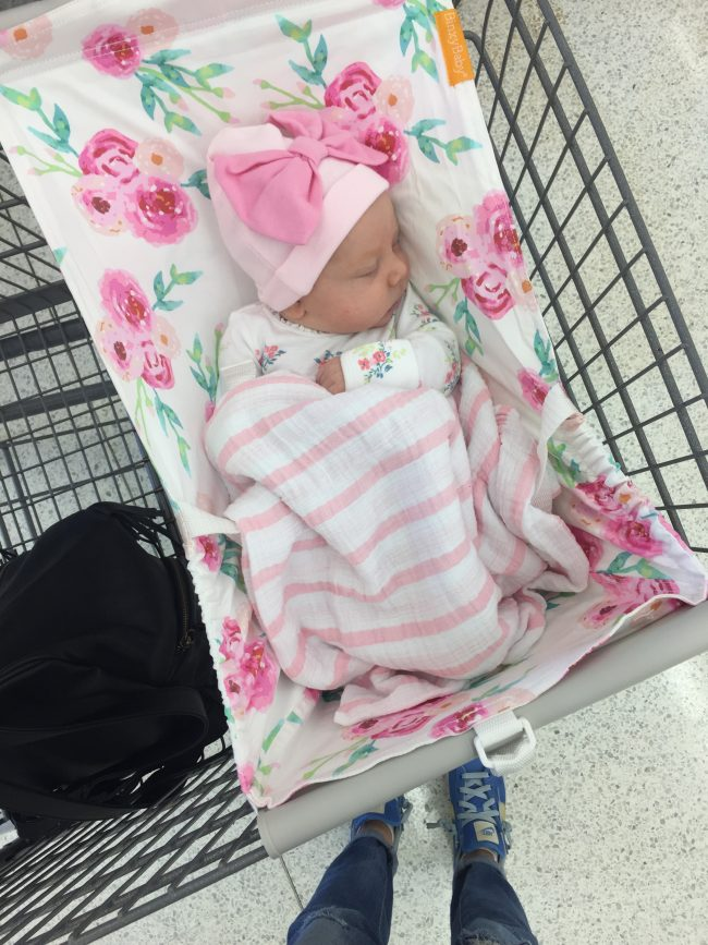 "Mom hack: A shopping cart hammock for baby so there's more room in the cart for your groceries and Target ""essentials"" like coffee...and wine!"