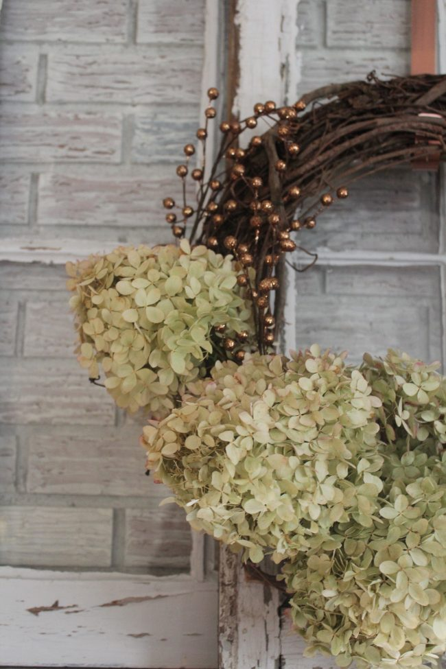 Hydrangea Wreath with Copper Accents - a simple DIY project that's SO inexpensive, but so pretty, too! Kansas City life, home, and style blogger Megan Wilson shares a DIY hydrangea wreath with copper accents | Life on Shady Lane \ @shadylaneblog