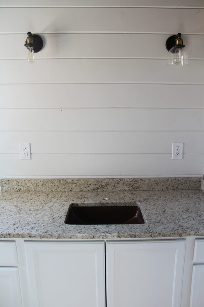 Modern farmhouse bathroom remodel: copper sink and granite countertops
