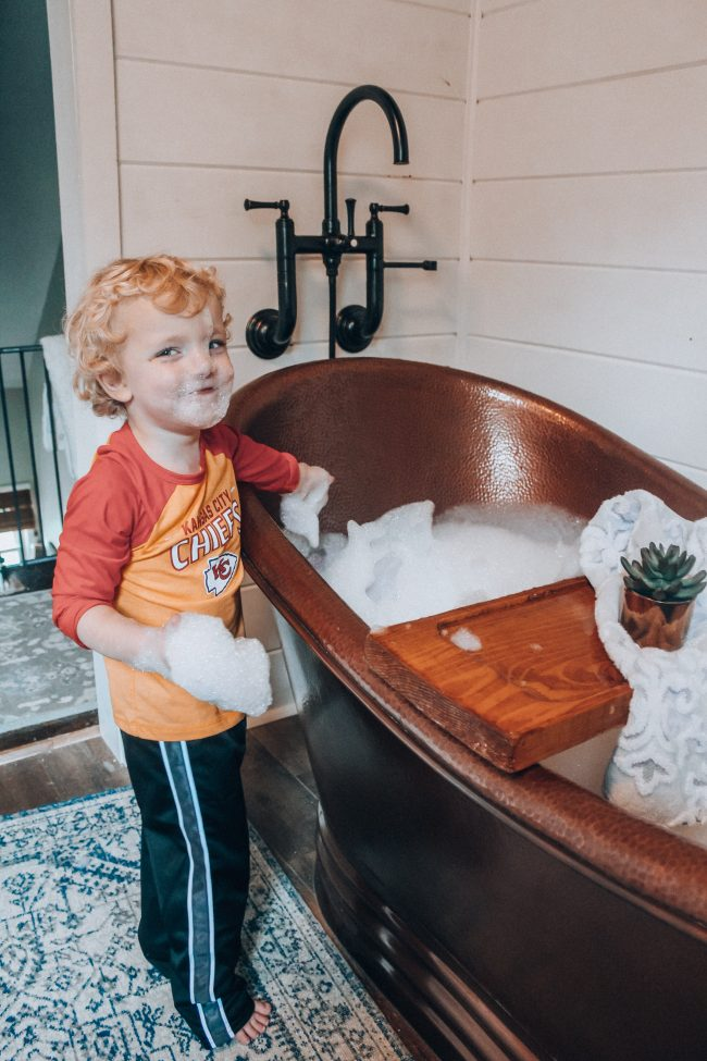 A DIY tub tray makes your bathroom feel just like a spa, and is perfect for holding all of your bath essentials!