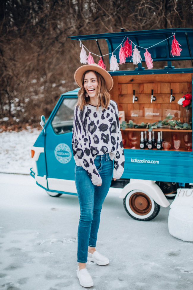 Animal print sweater and jeans, white sneakers | What is Galentine's Day? Here's what it is...and how to celebrate! | How to celebrate Galentine's Day | Kansas City life, home, and style blogger Megan Wilson shares ten ways to celebrate Galentine's Day!