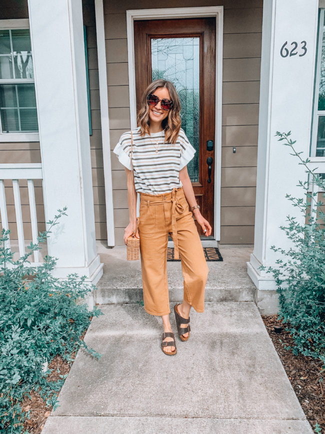 High waist paperbag pants // mustard colored pants and a striped flutter sleeve top // birkenstocks outfit // Vacation PACKING GUIDE - what I packed for a one week trip to San Antonio | Kansas City life, home, and style blogger Megan Wilson shares all of the items she packed for a one week spring break trip | What to pack for a one week spring break trip | lifeonshadylane.com | @shadylaneblog on IG