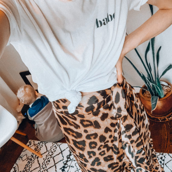 Leopard print skirt and a white knotted tee shirt   Casual everyday spring and summer fashion. Kansas City life, home, and style blogger Megan Wilson shares her Amazon Finds - April   Affordable cute style that's fun and won't break the bank! #amazon #amazonfashion #amazonclothes #amazonfinds #leopard #leopardprint