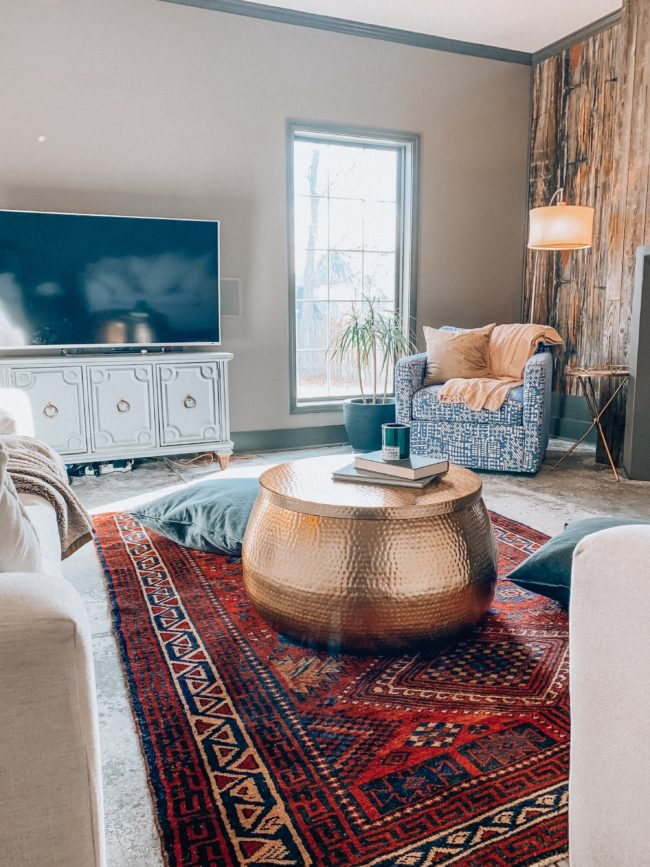 A unique, hammered gold coffee table WITH STORAGE! || Kansas City life, home, and style blogger Megan Wilson shares an update to her living room