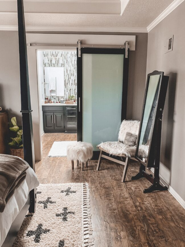Flokati chair and stool, black and white area rug in master bedroom || Neutral master bedroom design, plus the plans we have to change things up! Kansas City life, home, and style blogger Megan Wilson shares her master bedroom design plans and inspiration