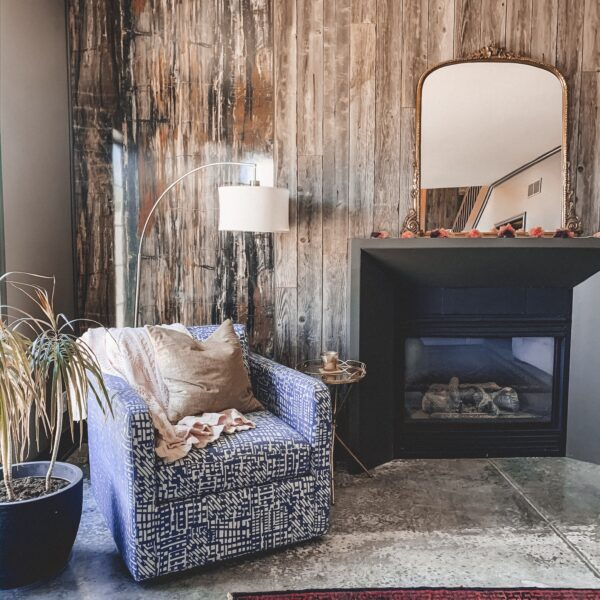 Gold Mirror over the Fireplace in the Living Room, white couch, wood planked fireplace wall || Kansas City life, home, and style blogger Megan Wilson shares a living room update