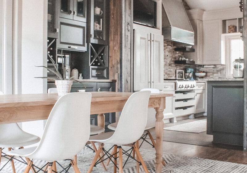 Dining room makeover - Part 3 of my Home Tour Series! || Kansas City life, home, and style blogger Megan Wilson shares her dining area makeover with an area rug, wood table, white dining chairs, wood floors, and lots of cabinetry!