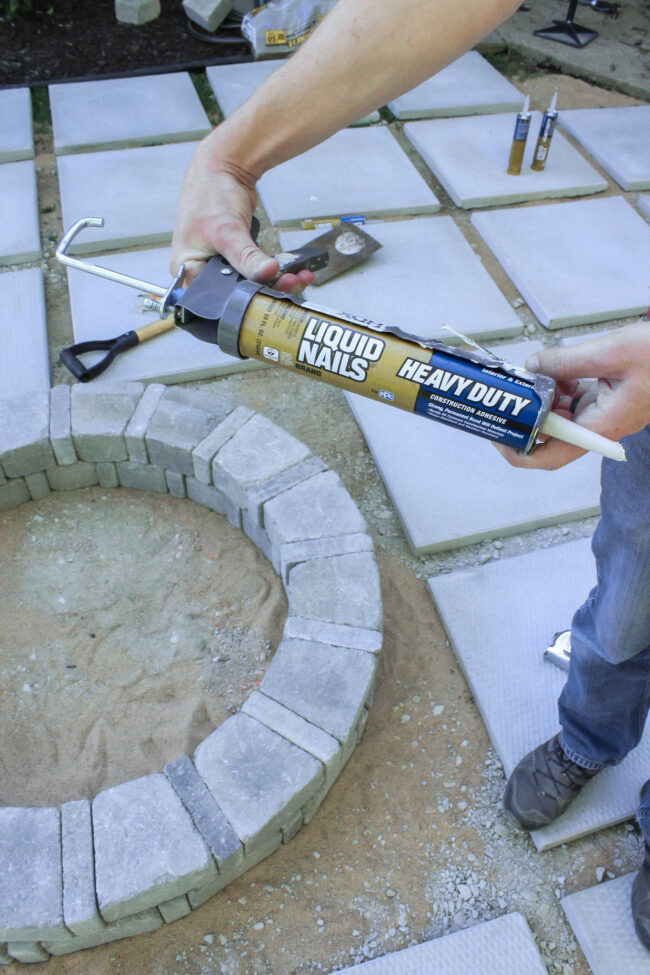 DIY paver patio and firepit - How to build your own patio and firepit! Patio with grass between pavers || Kansas City life, home, and style blogger Megan Wilson shares how to build your own patio and fire pit!