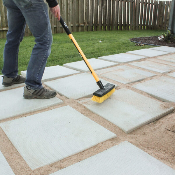 DIY patio with grass between pavers and fire pit