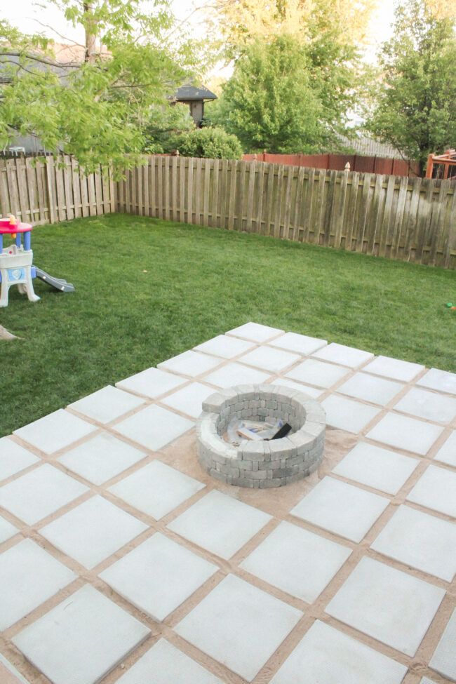 Diy Patio With Grass Between Pavers And A Fire Pit