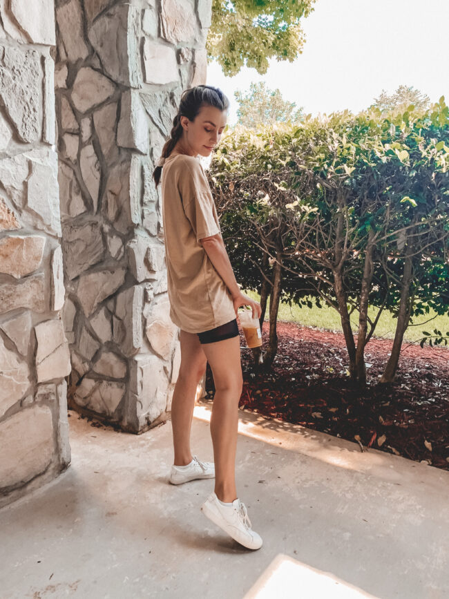 oversized boyfriend tee and black bike shorts outfit with white sneakers, Amazon sunglasses | @shadylaneblog shares the casual summer outfits you may have missed from Instagram in July