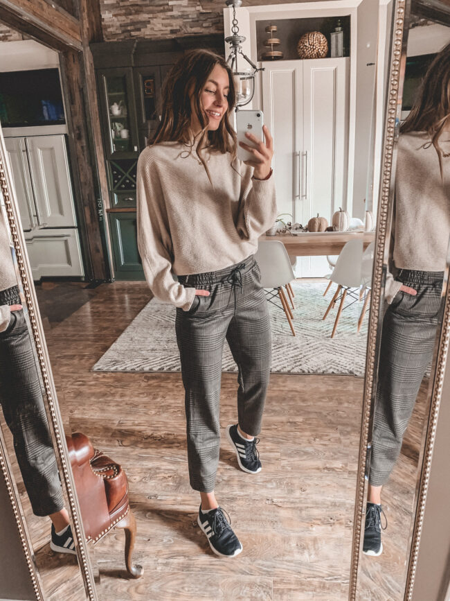 Neutral fall outfit with sneakers, plaid pants and tan sweater, black adidas sneakers, fall outfits 2020