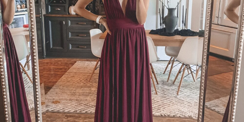 This fall and winter wedding guest dress is perfect for the holidays, comes in a ton of colors, and is really affordable! It's everything I look for in a wedding guest dress - sleek, simple, and super pretty. | Kansas City life, home, and style blogger Megan Wilson shares a dress that's perfect for the holidays, weddings, or any special occasion!